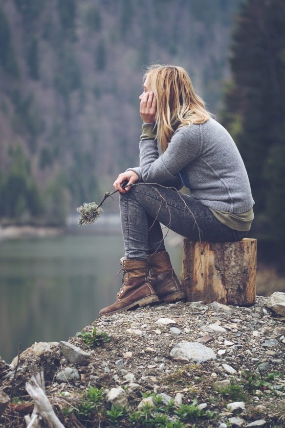 woman-meditating-on-a-lake-shore-PF24HBJ.jpg